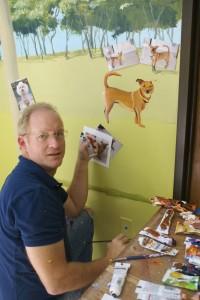 Jim Tweedy painting Mural at MCAS in North Houston